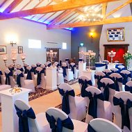 White stretch lycra chair covers with navy blue bow satin sashes