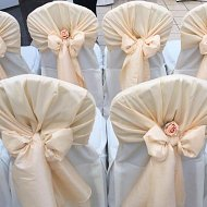 White cotton chair covers with taffeta pastel pink hood sash and rose decoration